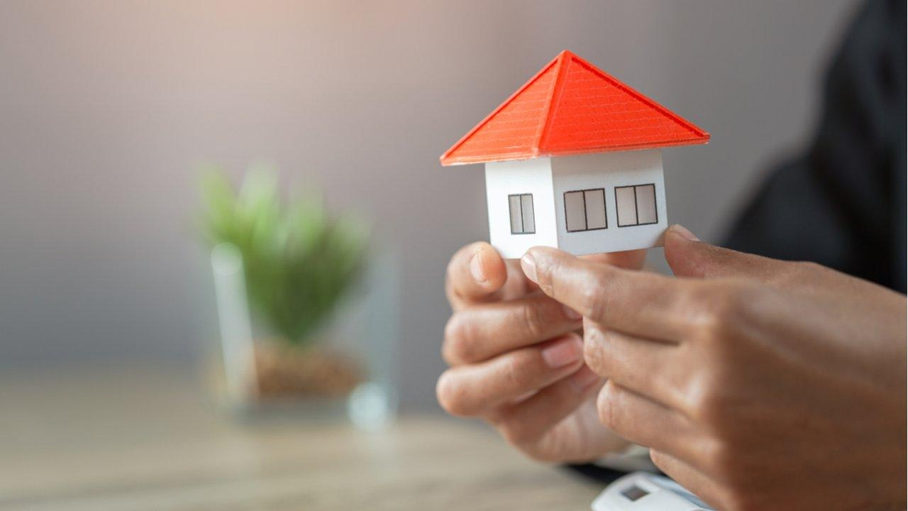Hands holding a rental property buy to let